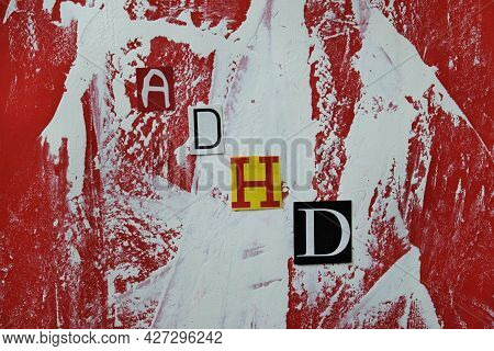 Adhd. Abbreviation Adhd From Paper Letters . Chaotic Red White Stripes Spots  Background. Adhd Is At