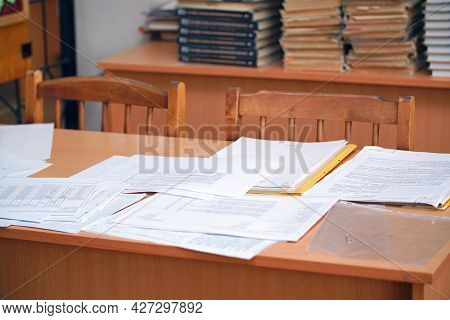Documents And Business Papers On The Desktop