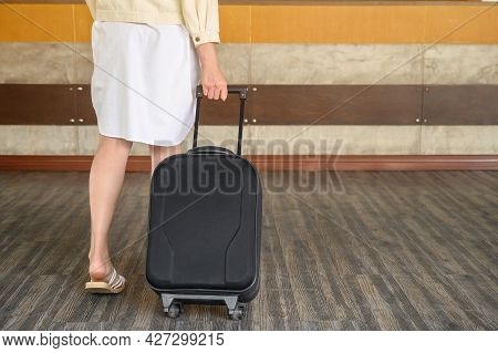 Cropped Shot Of Young Woman With Suitcase Walking To The Hotel Lobby For Check-in Her Room. Conceptu