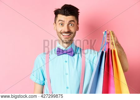 Image Of Happy Guy On Shopping, Holding Paper Bags And Smiling Excited, Shopper Buying With Discount