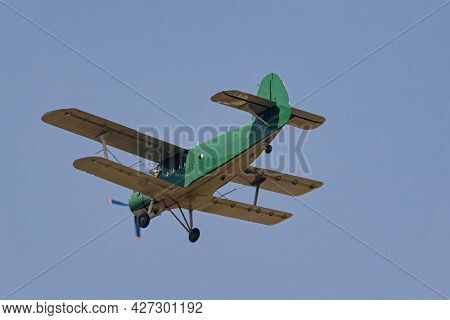 Light-engine Propeller Biplane Aircraft An-2 Flying In The Sky. View From The Ground