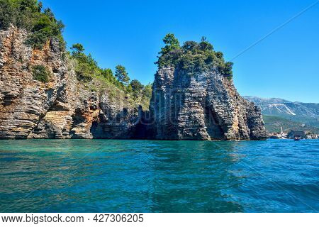 Picturesque View On Rocks On A Sunny Day From The Sea. Budva Riviera, Montenegro