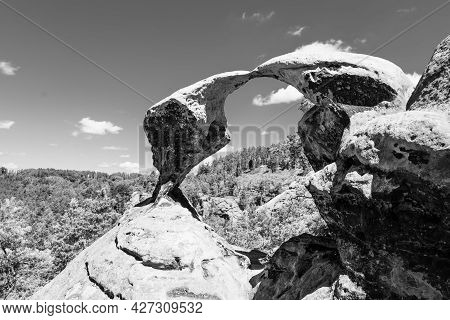 Unique Sandstone Arch In Pine Forest On Dry Sunny Summer Day. Bohemian Paradise, Czech Republic. Bla