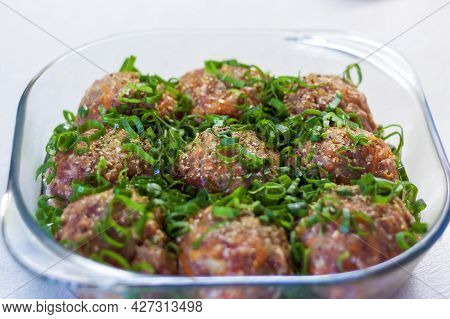 Raw Meatballs Made From Organic Meat, Vegetables And Spices, Ready For Baking In The Oven, Are An Ex
