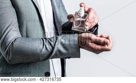 Fragrance Smell. Men Perfumes. Fashion Cologne Bottle. Man Holding Up Bottle Of Perfume. Men Perfume