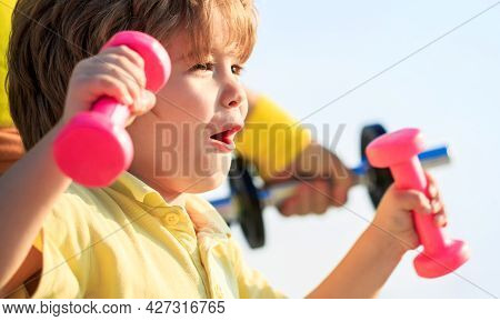Fitness Child. Sporty Boy With Dumbbells. Sport. Fitness, Health And Energy. Cheerful Boy Do Exercis