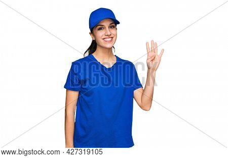 Young hispanic girl wearing delivery courier uniform showing and pointing up with fingers number four while smiling confident and happy.