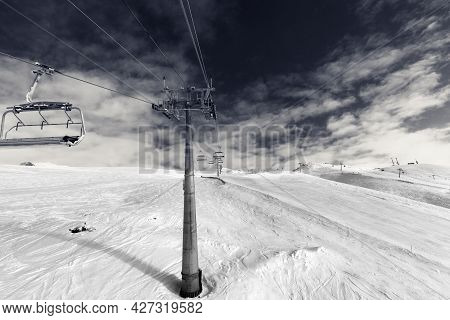 Snowy Ski Slope, Chair-lift On Ski Resort And Sky With Clouds At Wind Day. Caucasus Mountains In Win