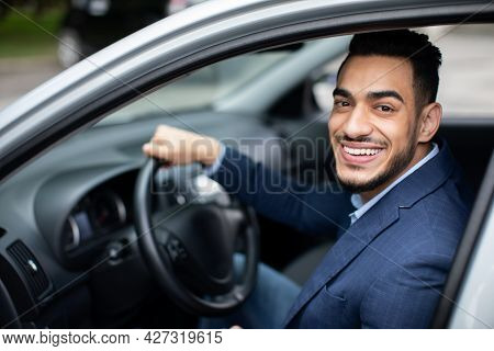 Happy Handsome Middle-eastern Businessman Driving Car To Airport, Side View