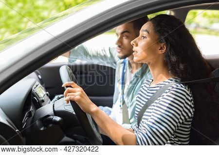 Nervous Young Lady Driving School Student Driving Car With Instructor