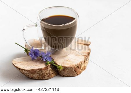 Chicory Drink In A Glass Cup On A White Background. Blue Chicory Flower. Alternative Coffee. Copy Sp