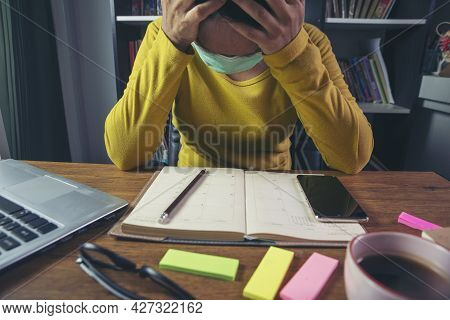 Unemployed Woman From The Spread Of Covid-19. Stressed Businesswoman Wear Mask, Work Feeling Tired,
