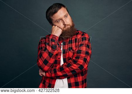 Bored, Uninterested Apathetic Handsome Bearded Guy, Tilt Head And Lean Face On Fist Look With Exhaus