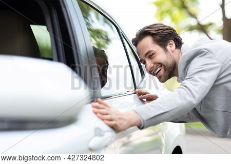Man Hugs New Car He Dreams About, Stand In Cars Showroom Near To White Automobile, Want To Buy It