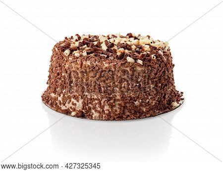 Whole Cake With Shavings Of White And Dark Chocolate Isolated On White Background. Water Droplets Co