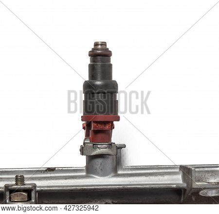 Used Fuel Injector Into The Combustion Chamber Of The Engine On A White Background. Car Spare Parts