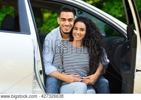 Beautiful Middle-eastern Lovers Enjoying Car Trip To Countryside