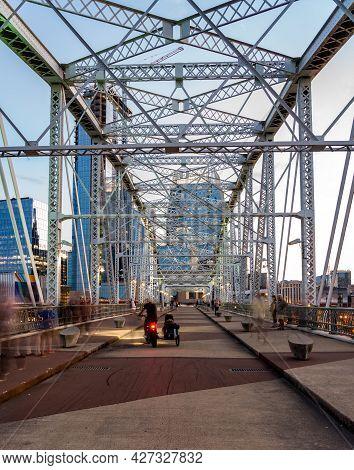 Tourists On The John Seigenthaler Pedestrian Bridge Or Shelby Street Crossing Leaving Downtown Nashv