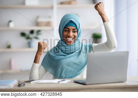 Great News. Happy Excited Black Muslim Lady Celebrating Success With Laptop