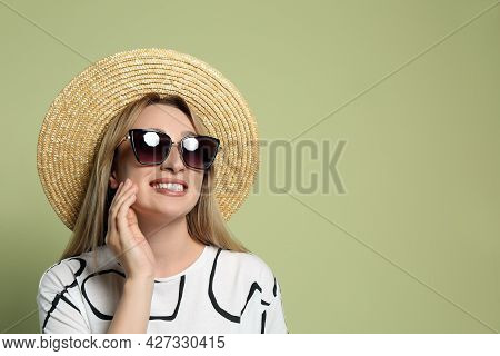 Beautiful Young Woman Wearing Straw Hat And Sunglasses On Light Green Background, Space For Text. St