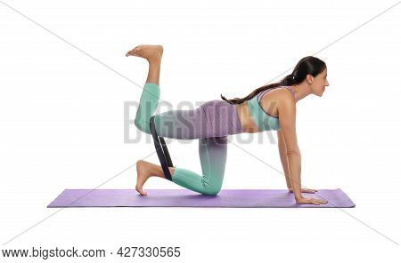 Woman Doing Sportive Exercise With Fitness Elastic Band On White Background