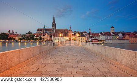 Regensburg, Germany. Panoramic Cityscape Image Of Regensburg, Germany With Old Stone Bridge Over Dan
