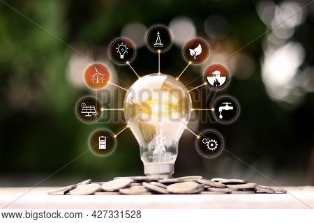 Glowing Energy-saving Light Bulb And Energy Icon Energy And Environment Concept