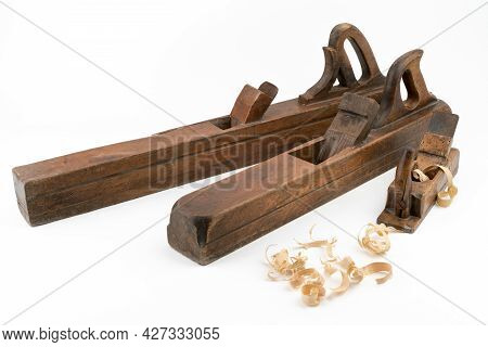 High Angle Studio Shot Of Three Vintage Wood Planers Of Different Sizes, Isolated On White Backgroun