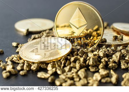 Ethereum Coins With Bitcoin On A Heap Of Gold Pebbles In Close-up On A Dark Background