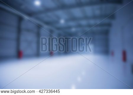 Blured Background Of Big Empty Modern Storehouse In Blue Tones