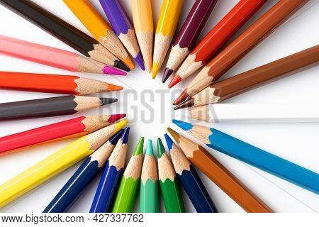 Colorful Pencils In Circle On White Background. Education Concept And Back To School Concept.top Vie
