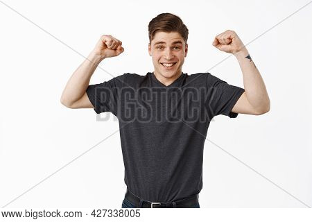 Excited Young Man Winning, Chanting And Celebrating Victory, Raising Hands Up In Hooray Triumph Gest