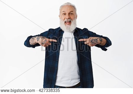 Old Happy Man With Tattoos And Long Grey Beard, Pointing At Himself With Excited Smiling Face, Winni