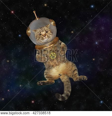 A Beige Cat Astronaut Wearing A Space Suit Is In Outer Space.