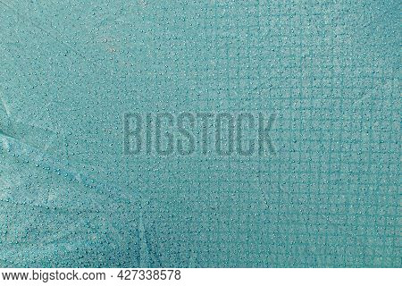 Many Little Water Drops On The Waterproof Turquoise Tarpaulin. Abstract Textured Background