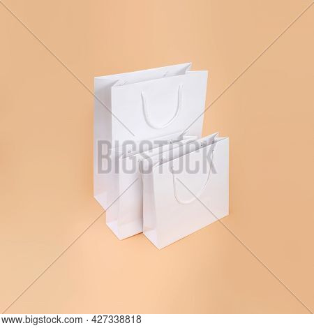 White Paper Bag Isolated On Simple Background