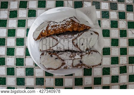 Sicilian Cannoli, Famous Traditional Pastries With Pure Sheep Ricotta Cheese,sugar And Pistachios In