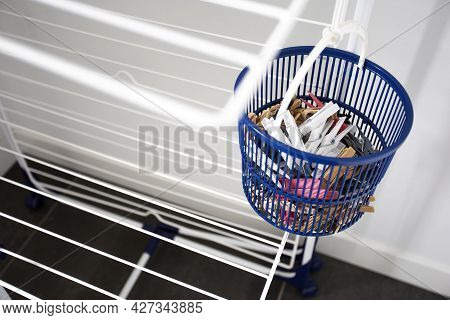 Empty Laundry Drying Rack With Clothespins In Blue Basket, Clothing Rack Dryer Clean New Design Indo