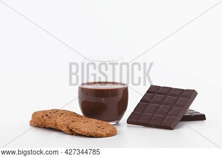 Glass Of Chocolate Milkshake With Cookies And Chocolate Bars: Selective Focus. Chocolate Concept