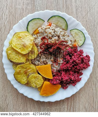 Pearl Barley With Soybeans, Carrots, Dried Tomatoes. Baked Potatoes, Pumpkin And Zucchini. Salad Wit