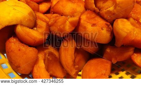Background Of Bright Beautiful Juicy Ripe Orange Apricots. The Texture Of The Fruit Halves, Slices T