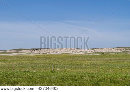 Badlands National Park, Sd, Usa - June 1, 2008: Landscape With White Geologic Deposits Appearing Fro