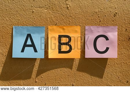 Abc Word From Colorful Paper Notes On Wall.
