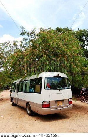 Polonnaruwa - October 16: The Bus For Tourists Transportation Is Near Rankoth Vehera Stupa In Polonn