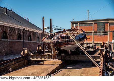 Den Helder, The Netherlands. 8 July 2021. Historic Flatboat On The Slipway At The Willemsoord Shipya