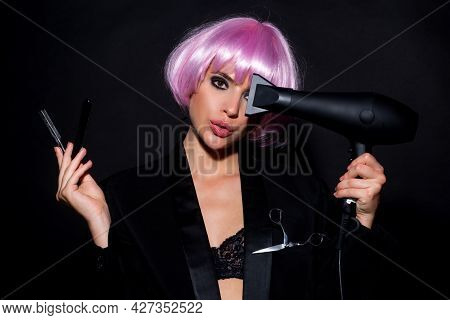 Fashion Woman With Hair Dryer And Razor Blade. Vogue Girl With Straight Hair Drying Hair With Profes