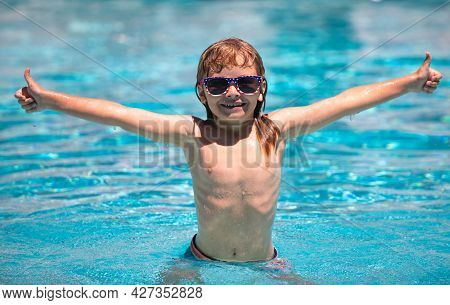 Child Boy Swim In Swimming Pool. Children Play In Tropical Resort. Family Beach Vacation. Kids Learn