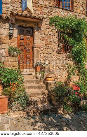 Close-up Of Stone House Facade With Bindweed And Staircase, At The Medieval Hamlet Of Les Arcs-sur-a