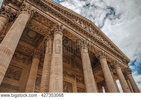 Columns At The Pantheon Entrance In Neoclassical Style And Cloudy Sky In Paris. One Of The Most Impr