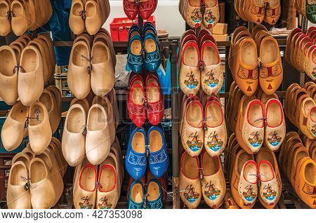 Gouda, Netherlands - June 29, 2017. Display With Several Types Of Colored Wooden Clogs, In A Typical